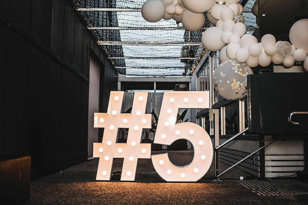 Light Up #5 with white balloon garland