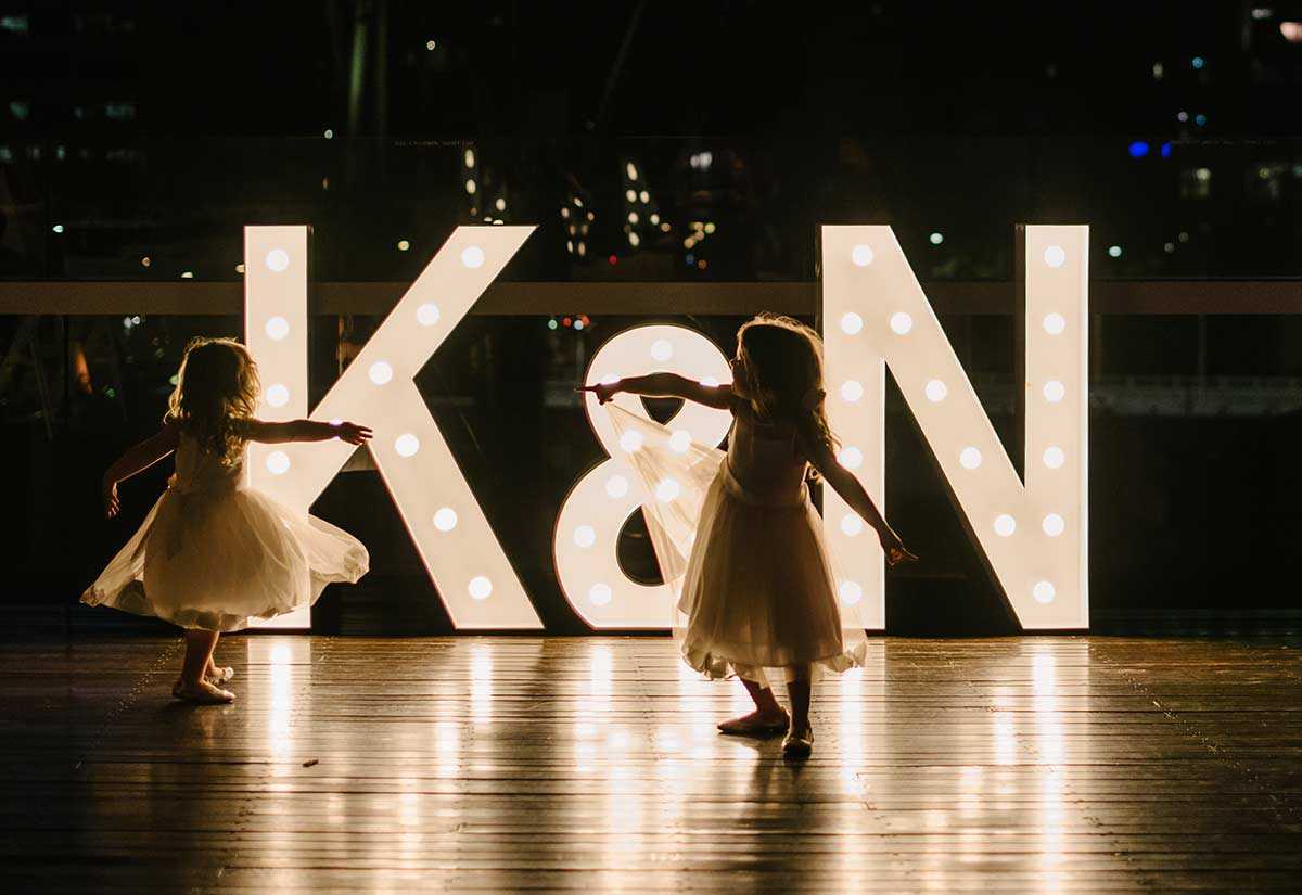 Kids dancing with light up 'K&N'