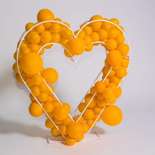 Geo Wire Heart filled with yellow balloons