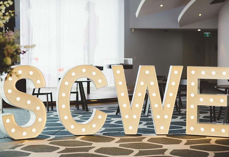 Light up letters 'SCWE'